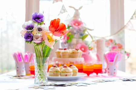Photo for Dessert table with cupcakes and flowers Easter party theme - Royalty Free Image