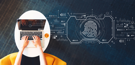 Photo pour Fingerprint scanning theme with person using a laptop on a white table - image libre de droit