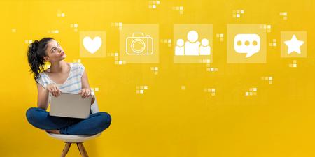 Photo pour Social media with young woman using a laptop computer - image libre de droit