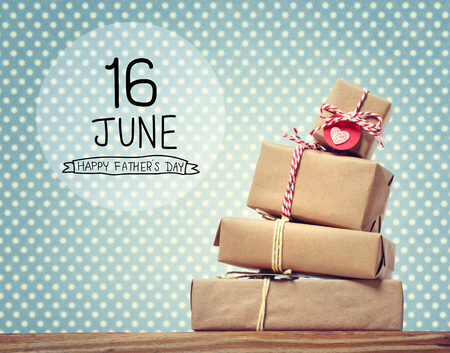 Photo pour Fathers Day message with stack of gift boxes - image libre de droit