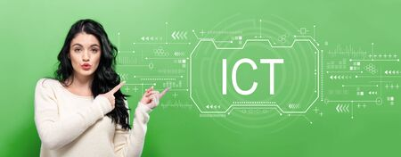Photo pour Information and communications technology with young woman pointing on a green background - image libre de droit