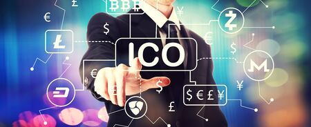 Cryptocurrency ICO theme with a businessman on a shiny backgroundの写真素材