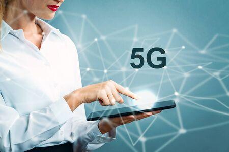 Photo pour 5G text with business woman using a tablet - image libre de droit