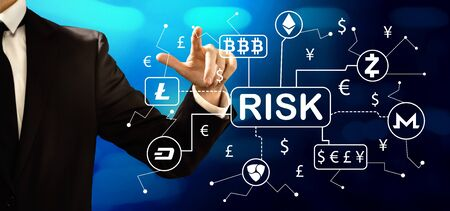 Cryptocurrency risk theme with businessman on a dark blue backgroundの写真素材