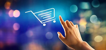 Foto de Online shopping theme with hand pressing a button on a technology screen - Imagen libre de derechos