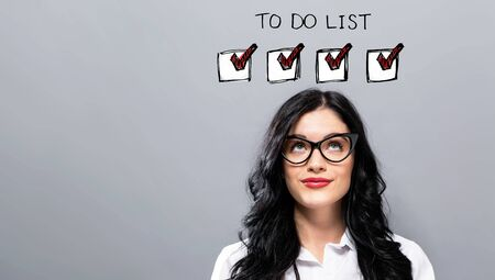 Photo for To do list with young businesswoman in a thoughtful face - Royalty Free Image