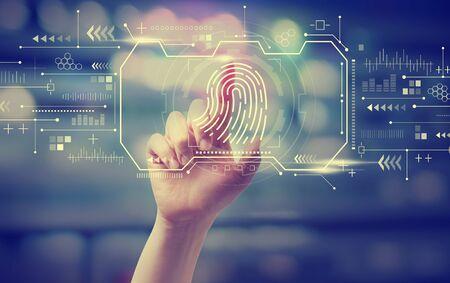 Photo pour Fingerprint scanning theme with hand pressing a button at night - image libre de droit
