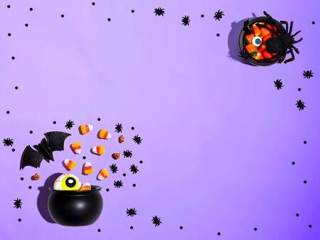 Foto de Halloween decorations with witch cauldron - overhead view flat lay - Imagen libre de derechos