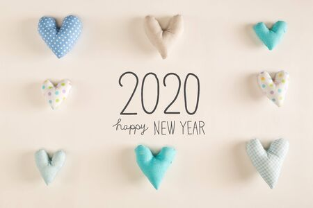 Photo for Happy New Year 2020 message with blue heart cushions on a white paper background - Royalty Free Image