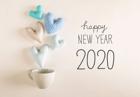 Photo for NEw Year 2020 message with blue heart cushions coming out of a coffee cup - Royalty Free Image