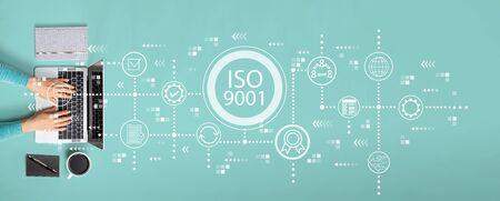 Photo pour ISO 9001 concept with person using a laptop - image libre de droit