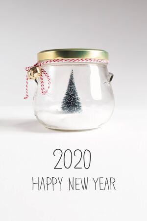 Photo for 2020 Happy New Year message with Christmas tree in a glass Jar - Royalty Free Image