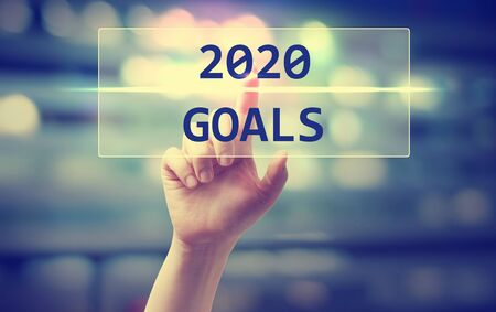 Photo pour 2020 Goals concept with hand pressing a button on blurred abstract - image libre de droit