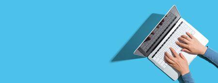 Photo pour Person using a laptop computer from above - image libre de droit