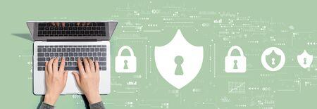 Photo pour Cyber security theme with person using a laptop computer - image libre de droit