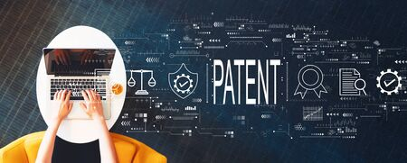 Photo for Patent concept with person using a laptop on a white table - Royalty Free Image