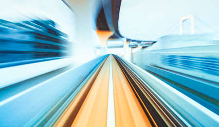 Photo pour Abstract high speed technology POV train motion blurred concept from the Yuikamome monorail in Tokyo, Japan - image libre de droit