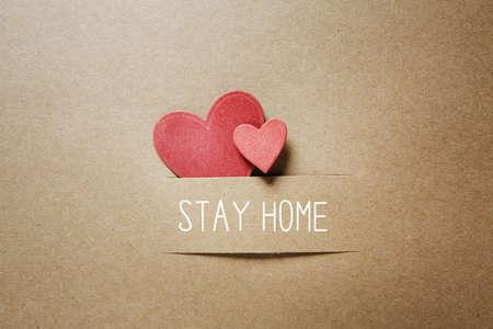 Foto de Stay home theme with handmade small paper hearts - Imagen libre de derechos