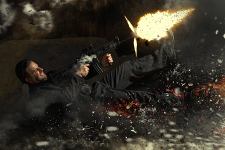 View of a contracted type killer agent thrown in middle air from an explosion firing a machine gun.