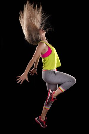 Photo for Fitness exercise girl  dance in black background. - Royalty Free Image