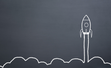 Photo for chalk drawing rocket on blackboard Going up quickly - Royalty Free Image