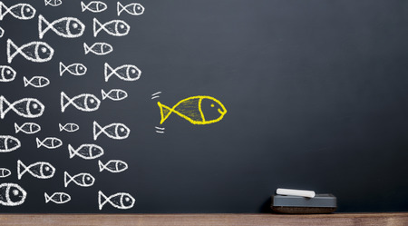 Foto de The concept of leadership. Big fish leads to a herd of fish - Imagen libre de derechos