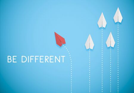 Foto de be different concept. red paper airplane is flying in different direction from white paper airplanes - Imagen libre de derechos
