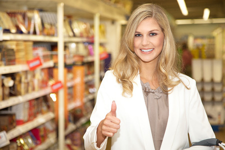 pretty young woman in supermarket