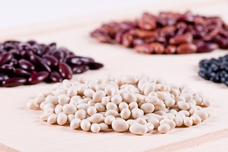 Different haricot beans on the wood table