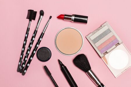 Photo for Blushes, brushes and a lipstick for make up on a pink background - Royalty Free Image