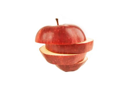 Photo for An apple cut in slices on a white background - Royalty Free Image