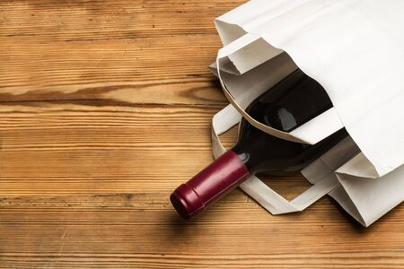 Photo for Bottle of red wine in a paper bag - Royalty Free Image