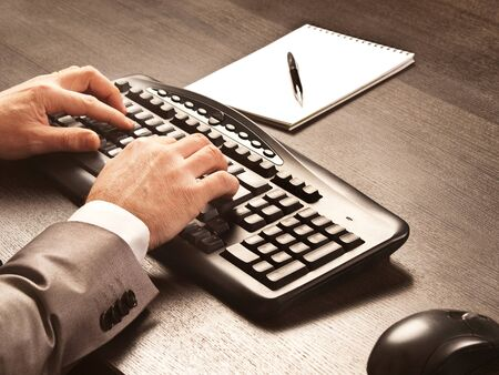 Photo for Man writing on computer keyboard - Royalty Free Image