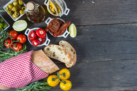 Spanish tapas on wooden rustic table from above