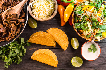 overhead view on authentic mexican street taco with beef and vegetables