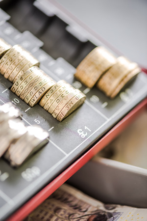 Pound sterling coins in cash register, from above view