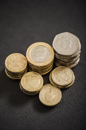 British coins stack on black, pound sterling