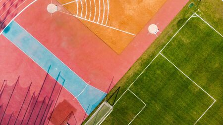 Photo for Athletic stadium and football grass pitch, aerial top down view - Royalty Free Image