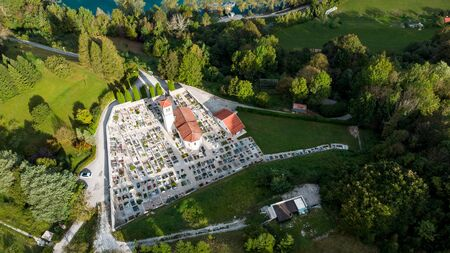 Church and Cemetery at Most na Soci in Slovenia. Aerial Drone View.