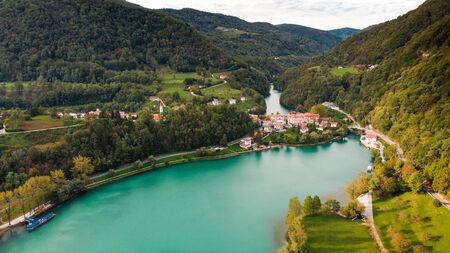 Most Na Soci Town at Emerald Lake Edge. Aerial View of Slovenia Countryside.