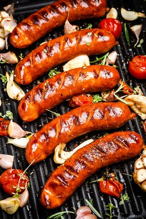 Photo pour BBQ Grilled Meat Sausages with Herbs,Spices and Vegetables. Summer Party Food . - image libre de droit