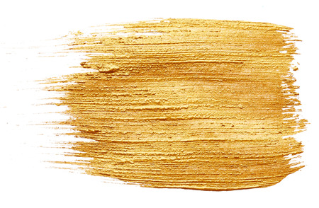 Strokes of golden paint isolated on white background