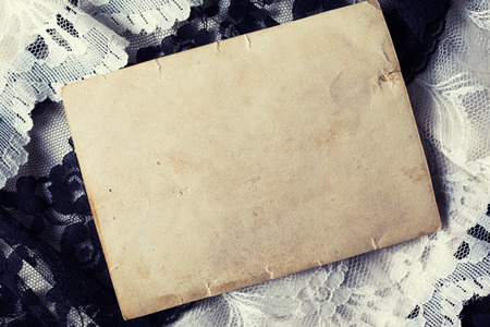 Blank photo paper on vintage background