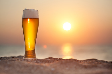 Photo for Glass of beer on a sunset   - Royalty Free Image