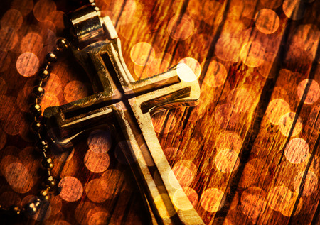Photo for Closeup of silver Christian cross on bible - Royalty Free Image