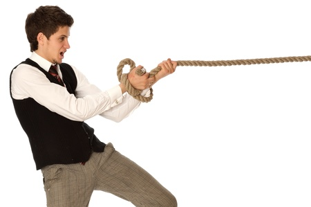 strong-willed man pulling of a rope and wins as a symbol of business success