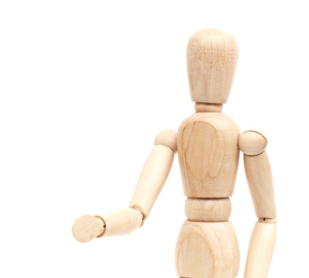A wooden mannequin give a hand, greets. isolated on white