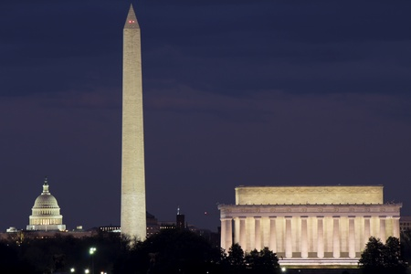 View of Washington DC with Capitol, Washington Monument and Lincoln Memorial in line, at dusk