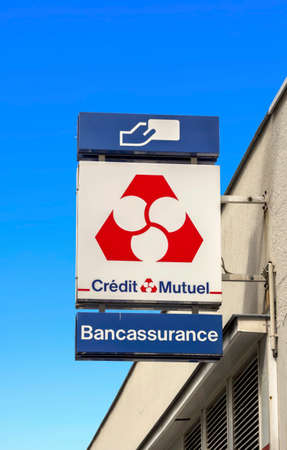 Le Havre, France : Credit mutuel logo on a wall. Credit Mutuel is a major French bank, with headquarters in Strasbourg, Alsace