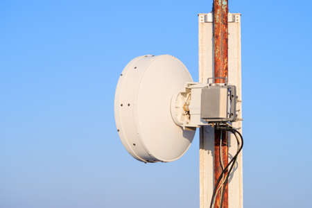Photo for a round transmitter on a base station stand. cellular communication transmitter element against the sky - Royalty Free Image
